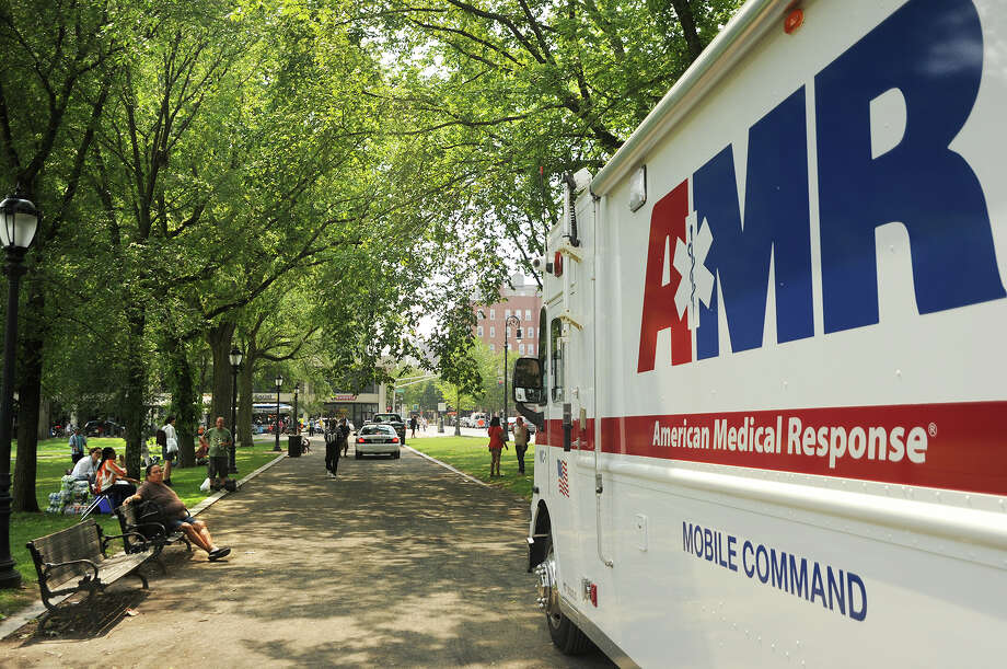 An AMR mobile command truck is parked on the New Haven Green as crews spread out to treat numerous drug overdose victims in New Haven, Conn. on Thursday, August 16, 2018. Distribution of the illegal drug K-2 has resulted in a stream of overdoses, centered mainly on the Green, in the last two days. Photo: Brian A. Pounds, Hearst Connecticut Media / Connecticut Post