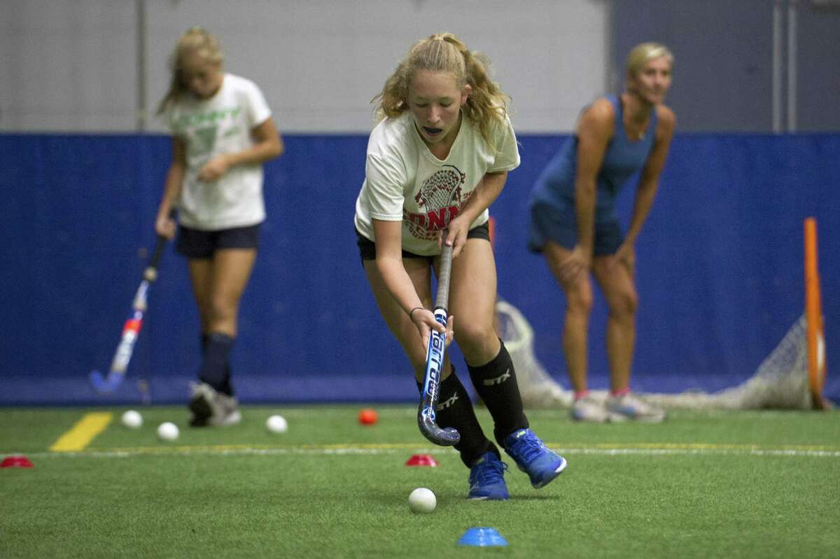13-year-old Ellie Johnson, of Greenwich, participates in a field hockey drill during the Girls Leadership Camp inside Chelsea Piers on Blachley Rd. in Stamford, Conn. on Wednesday, Aug. 15, 2018. This is the first taste of field hockey at Chelsea Piers and will soon start a field hockey program.