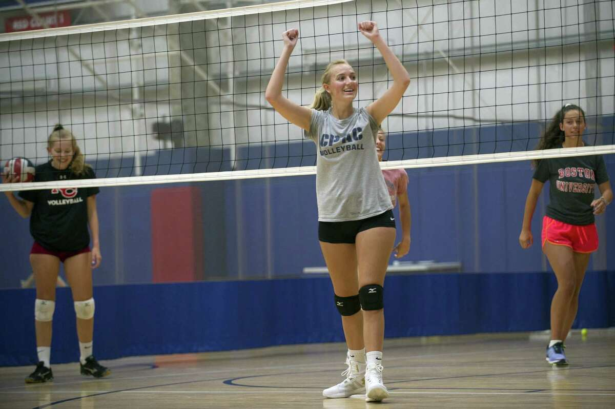 17-year-old Venae Rosdahl, of New Canaan, cheers after winning a point while playing volleyball during the Girls Leadership Camp inside Chelsea Piers on Blachley Rd. in Stamford, Conn. on Wednesday, Aug. 15, 2018.