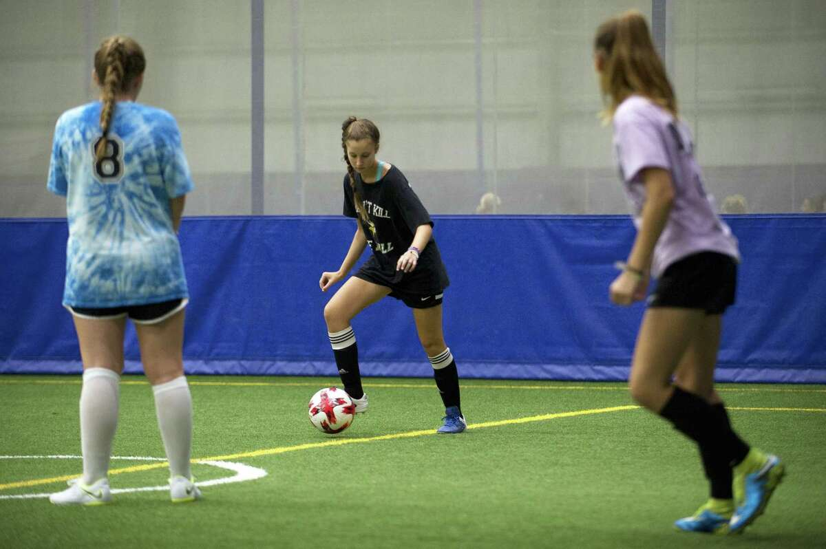 14-year-old Emma Romain, of Stamford, dribbles a ball while participating in a soccer drill during the Girls Leadership Camp inside Chelsea Piers on Blachley Rd. in Stamford, Conn. on Wednesday, Aug. 15, 2018.