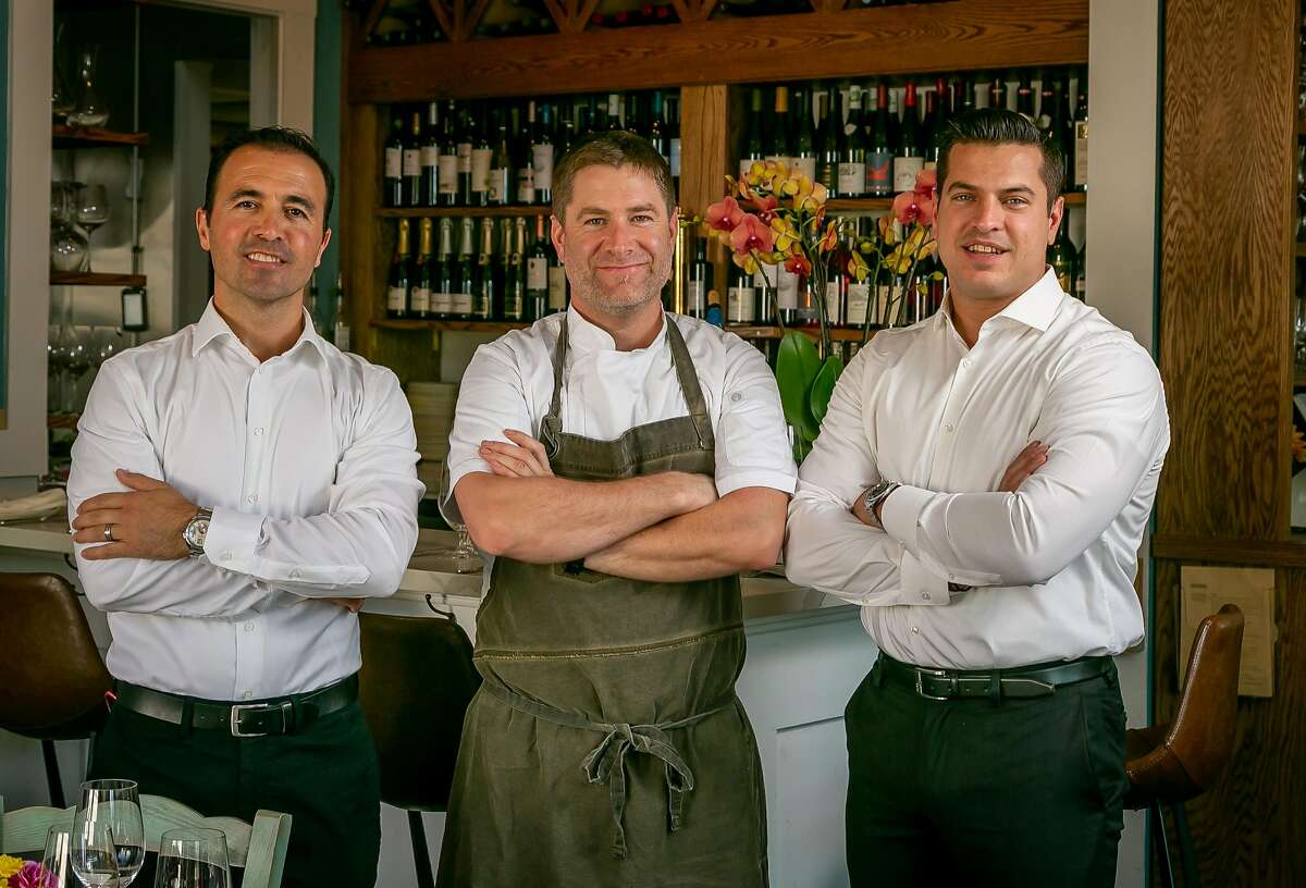 Left to right; Owners Hakan Bala, Chef William Roberts, and Thanasis Pashalidis at Taverna in Palo Alto, Calif. are seen on August 13th, 2018.