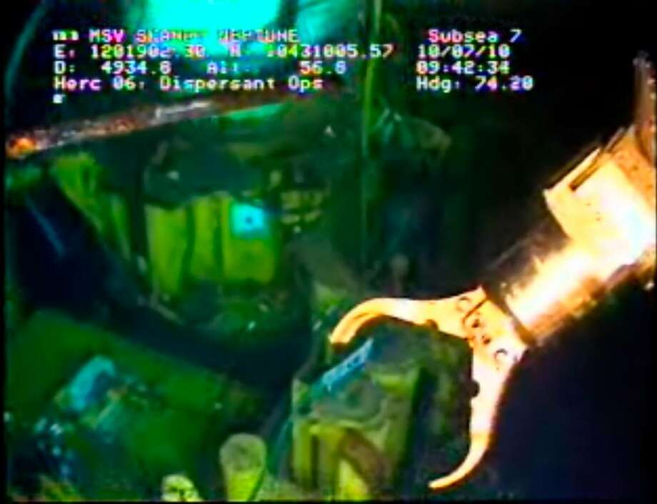 n this image taken from video provided by BP PLC, the arm of a remotely operated vehicle works at the Deepwater Horizon oil spill site in the Gulf  Undersea robots manipulated by engineers a mile above were expected to begin work Saturday removing the containment cap over the gushing well head in the Gulf of Mexico to replace it with a tighter-fitting cap that could funnel all the oil to tankers at the surface. If all goes according to plan, the tandem of the tighter cap and the tankers could keep all the oil from polluting the fragile Gulf as soon as Monday. But it would be only a temporary solution to the catastrophe unleashed by a drilling rig explosion. It won't plug the busted well and it remains uncertain that it will succeed. (AP Photo/BP PLC) NO SALES