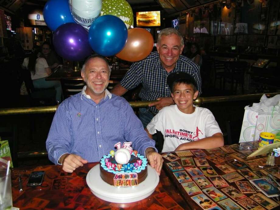 From left, Sky Mercede Sr., Bobby Valentine and Sky Mercede II celebrating the Mercedes' birthdays July 3 at Bobby Valentine's Sports Gallery Cafe in Stamford.  contributed Photo: Contributed Photo / Greenwich Time Contributed