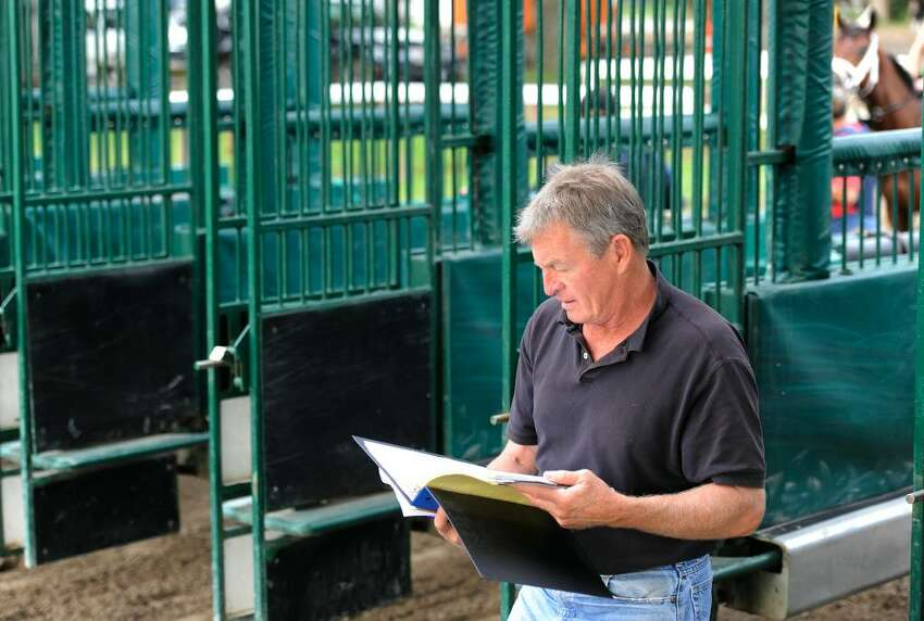 Bob Duncan, former Starter at NYRA tracks, who now acts in a consulting position uses his gentler way in helping horses get their starters card so they can go to the gate at race tracks, works with horses of all ages at the Oklahoma Training Track in Saratoga Springs, New York June 22, 2010. (Skip Dickstein/Times Union)