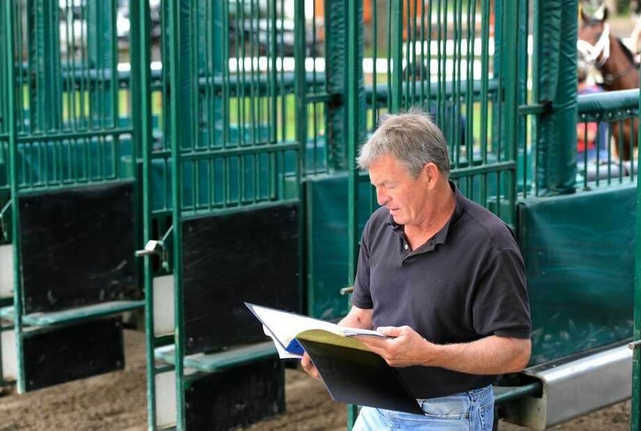 Bob Duncan, former Starter at NYRA tracks, who now acts in a consulting position uses his gentler way in helping horses get their starters card so they can go to the gate at race tracks, works with horses of all ages at the Oklahoma Training Track in Saratoga Springs, New York June 22, 2010.    (Skip Dickstein/Times Union) Photo: Skip Dickstein