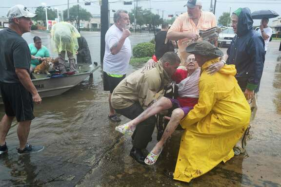 Neighbors used their personal boats to rescue Jane Rhodes during on Aug. 27, 2017 flooding in Friendswood.