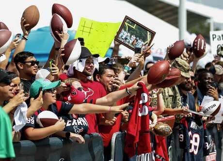 Houston Texans fans seek autographs following a joint practice between the Texans and the San Francisco 49ers at the Methodist Training Center on Thursday, Aug. 16, 2018, in Houston.