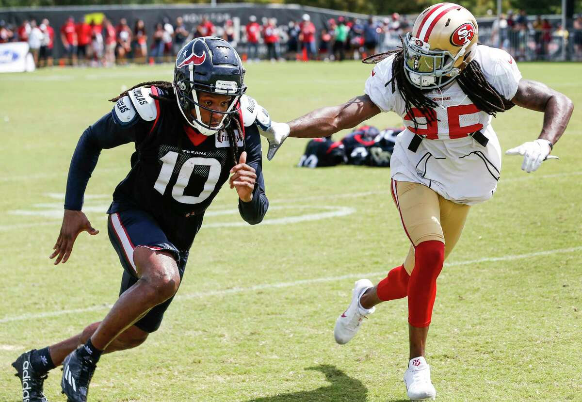 Houston Texans wide receiver DeAndre Hopkins (10) and San Francisco 49ers defensive back Richard Sherman (25) run extra drills after a joint practice between the Texans and 49ers at the Methodist Training Center on Thursday, Aug. 16, 2018, in Houston.