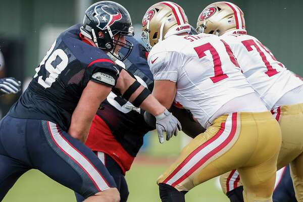 Houston Texans defensive end J.J. Watt (99) runs past San Francisco 49ers offensive tackle Joe Staley (74) as he rushes the passer during a joint practice between the Texans and 49ers at the Methodist Training Center on Thursday, Aug. 16, 2018, in Houston.