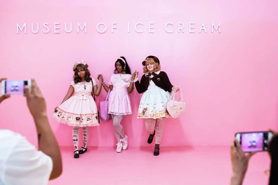 From left, Christina Morris, Tanaya Torres and Tara Hayes pose for photos at the Museum of Ice Cream's Pint Shop. Photo: Photo By Karsten Moran For The Washington Post. / For The Washington Post