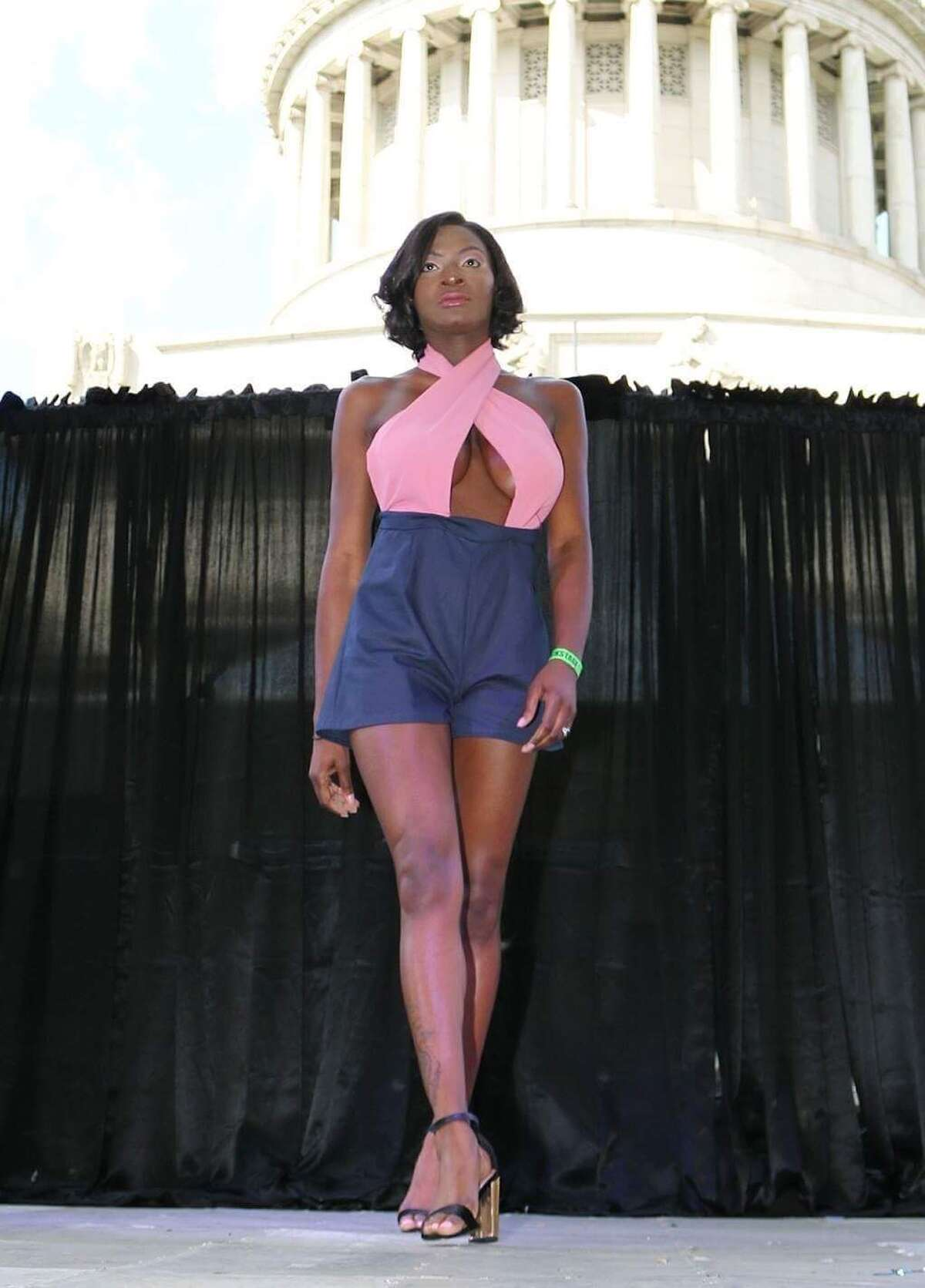 A model wears a piece from Stamford native Brianna Cummings' collection, Meraki Essence, during Harlem Week on July 29, 2018.