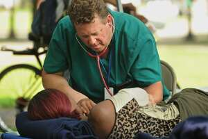 One of three simultaneous drug overdose victims is treated on the New Haven Green Thursday.