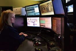 A dispatcher works a call at The Woodlands Fire Dept. Fire Station 1. Officials with The Woodlands Fire Department are encouraging all residents of the township to register themselves and create a profile with Smart911, a free service associated with the Montgomery County Emergency Communications District intended to help first responders when an emergency occurs.