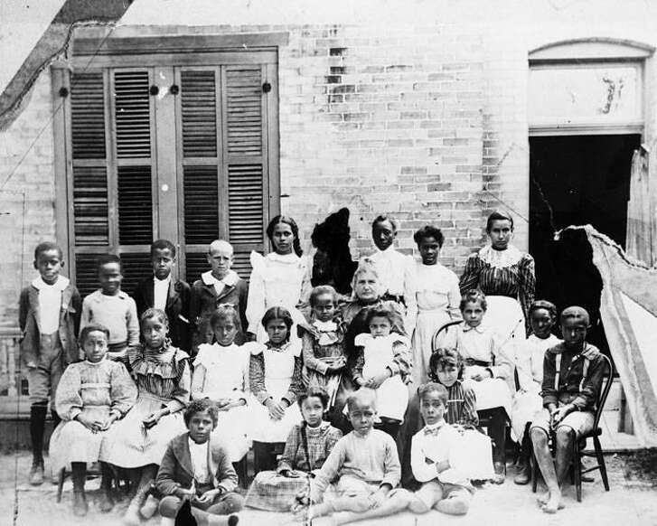 Students outside of the St. Phillips Normal and Industrial School in 1898 where they were a part of the first sewing class.