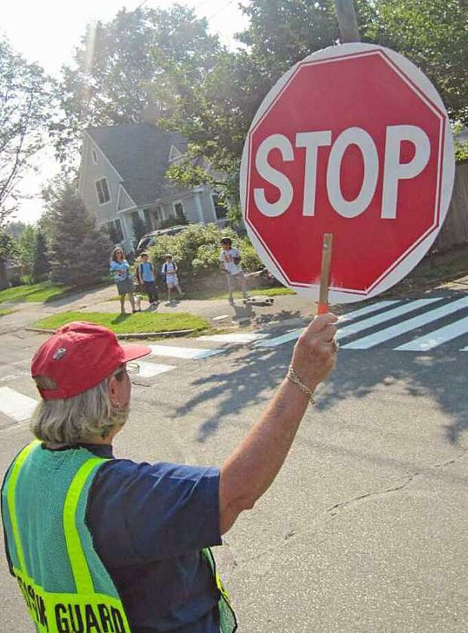 Crossing guards will be manning their posts when school opens at the end of the month. Photo: Hearst Connecticut Media File Photo / Fairfield Citizen