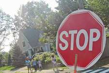 Crossing guards will be manning their posts when school opens at the end of the month.