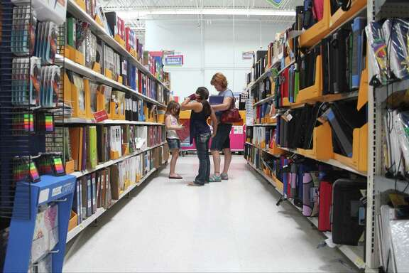 Maryann Shuff, right, shop for school supplies with her daughter Jessica and her friend Mariah Batres at Walmart in Atascocita during tax-free weekend on August 17.
