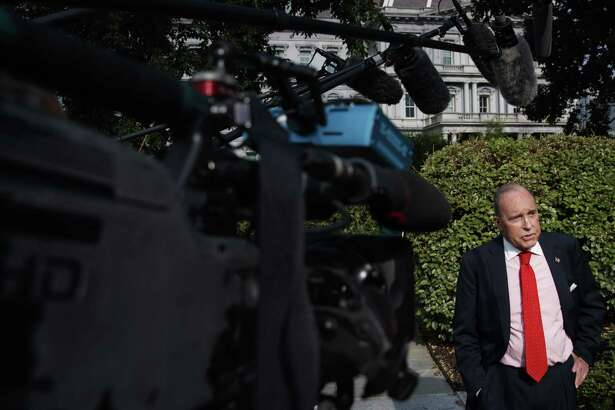 Larry Kudlow, the White House economic adviser, speaks to reporters outside the White House in Washington, Aug. 16, 2018. The U.S. and China will return to the negotiating table late this month in an attempt to ease months of building tensions since trade talks broke down this year and both countries began imposing escalating rounds of tariffs on each other. Kudlow said that the demands of the U.S. have not changed, and that China must lower its tariff and non-tariff barriers and cease the theft of American intellectual property.