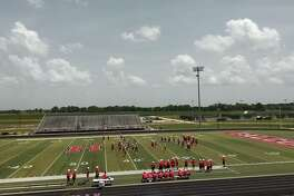 The Hargrave Falcon football team practices at Falcon Stadium in Huffman
