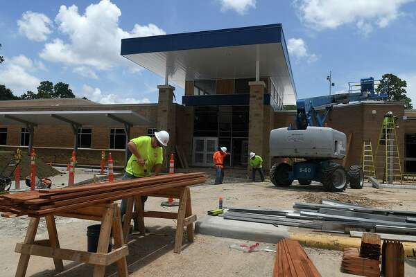 Construction crews work on the new entrance at Lemm Elementary earlier this summer part of the reconstruction to the school building after flooding from Hurricane Harvey.