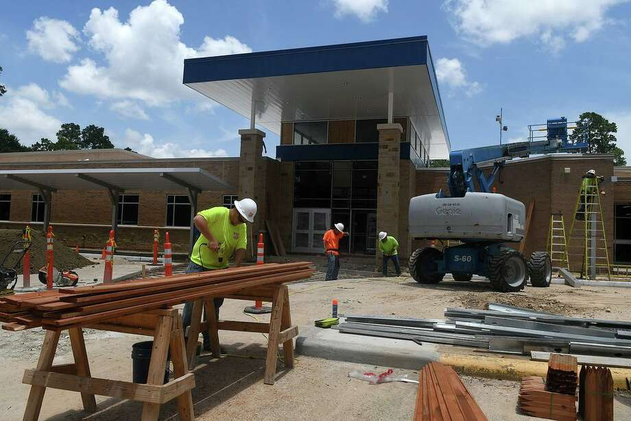 Construction crews work on the new entrance at Lemm Elementary earlier this summer part of the reconstruction to the school building after flooding from Hurricane Harvey. Photo: Jerry Baker/For The Chronicle