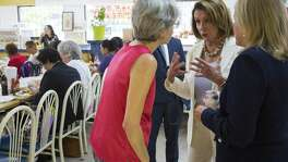 House Minority Leader Nancy Pelosi and Democratic congressional candidate state Sen. Sylvia Garcia talk with people at Gerardo's Drive-In in Houston.