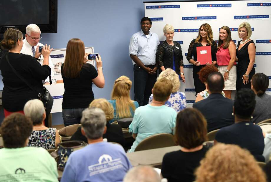 Through a $491,285 grant donated by the Rebuild Texas Fund, The foundation for Southeast Texas handed out several checks to local nonprofit organizations during an event in Beaumont Thursday.   Photo taken Thursday, 8/16/18 Photo: Guiseppe Barranco/The Enterprise, Photo Editor / Guiseppe Barranco ©