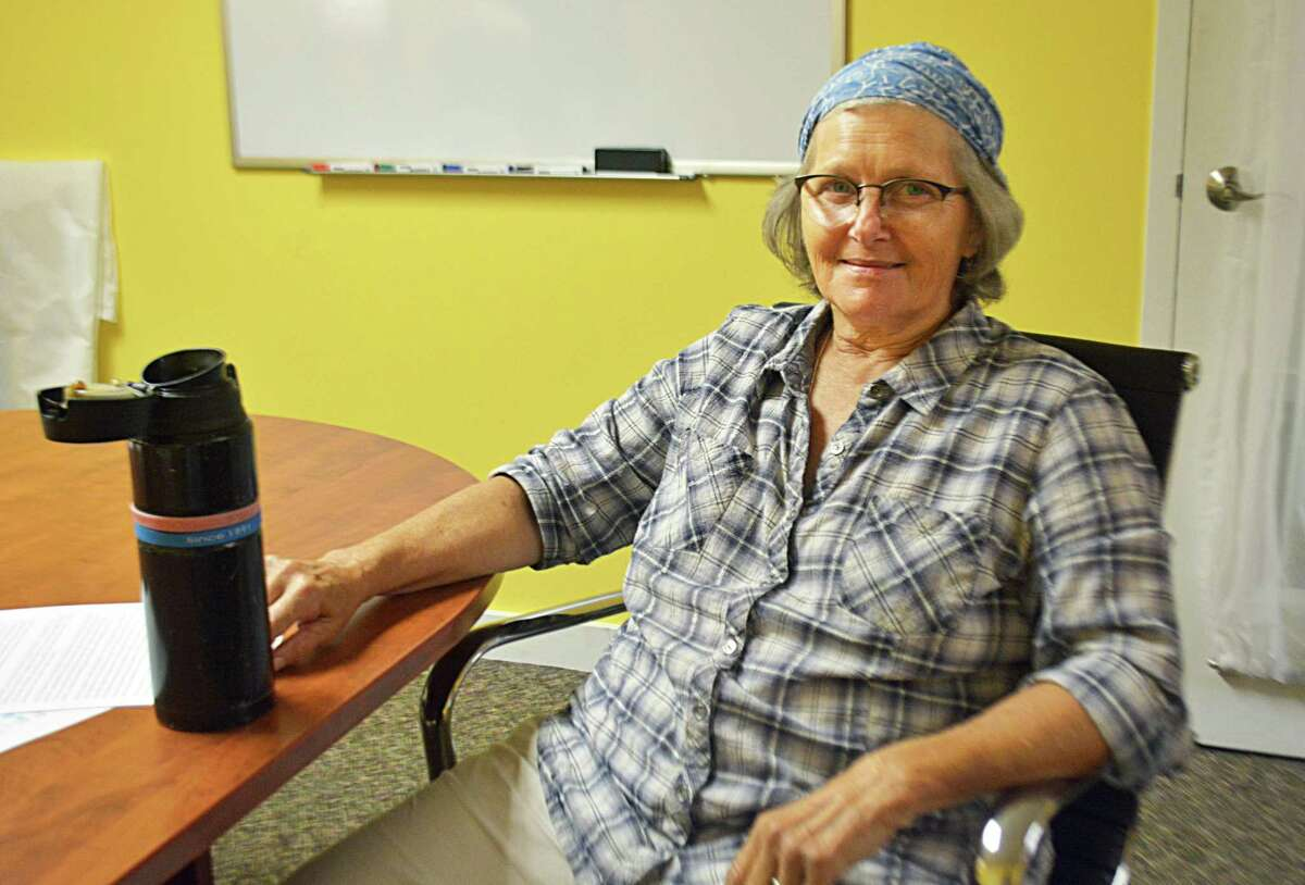 """Ann Smith works on programming and community engagement at Russell Library in Middletown. She was all set to be a kidney donor to her friend's son Alan Dougherty of Meriden after undergoing extensive testing and evaluations, but was deemed """"too frail"""" to undergo the procedure."""