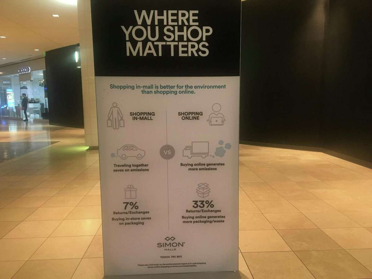 A sign inside The Galleria shopping mall in Houston touts the environmental benefits of shopping in brick-and-mortar retail stores rather than ordering goods online.
