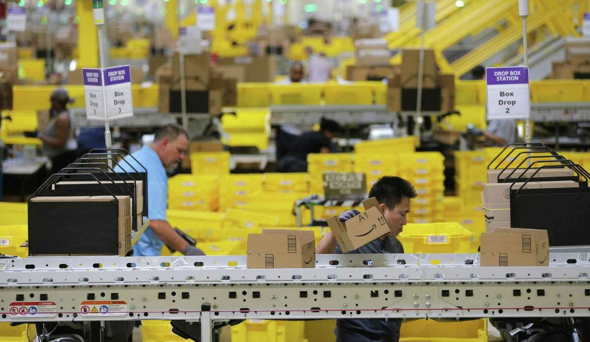 Associates prepare boxes for shipping as employees fill orders at Amazon Fulfillment Center in Haslet, Texas on Monday, November 28, 2017. (Rodger Mallison/Fort Worth Star-Telegram/TNS)