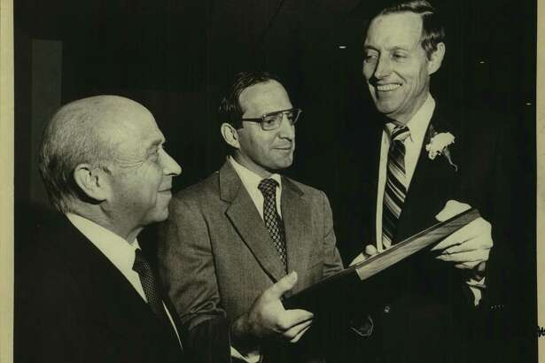 Banker Tom C. Frost, right, here receiving a human relations award in 1981, always put San Antonio first.