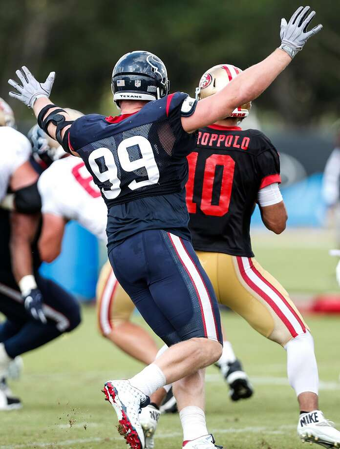 Houston Texans defensive end J.J. Watt (99) puts up his hands as she stops short of hitting San Francisco 49ers quarterback Jimmy Garoppolo (10) on a pass play during a joint practice between the Texans and 49ers at the Methodist Training Center on Thursday, Aug. 16, 2018, in Houston. Photo: Brett Coomer / Staff Photographer