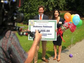 Milford woman gets surprise visit, check from Publishers