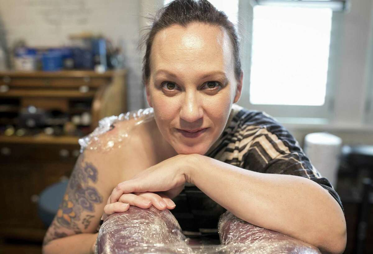 M.J. Hegar, who is running for the Democratic nomination for the congressional seat occupied by Round Rock Republican John Carter, gets a tattoo to cover up shrapnel scars at Arthouse Tattoo on Monday November 13, 2017. JAY JANNER / AMERICAN-STATESMAN