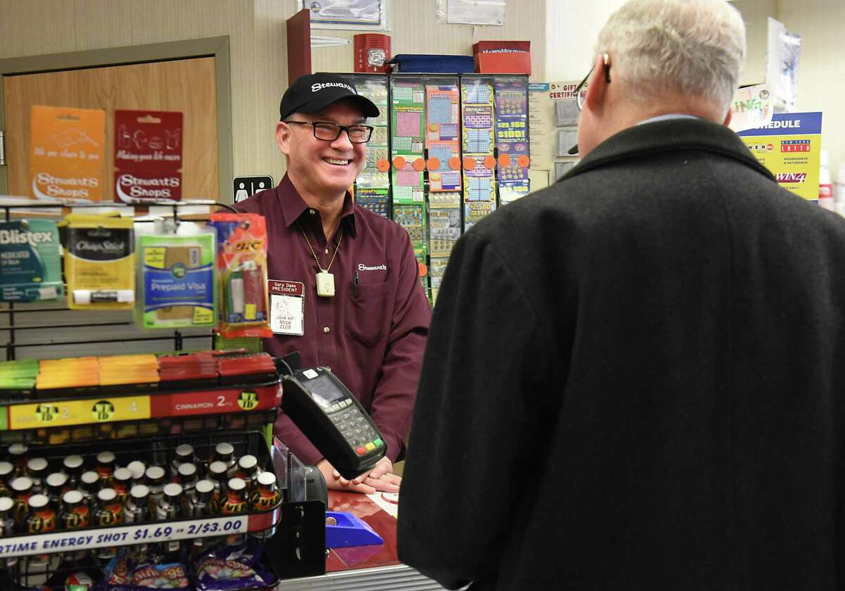 StewartOs Shops President Gary Dake chats with customer Bill Nathan of Slingerlands as he continues a Holiday Match tradition by working a shift at the StewartOs Shop on Sand Creek Road on Friday, Feb. 3 2017 in Colonie, N.Y. The 2016 Holiday Match campaign received donations of more than $926,000 which becomes more than $1.85 million with the StewartOs match. Nathan, who used to work right up the road, gave Dake a donation for the cause. (Lori Van Buren / Times Union)
