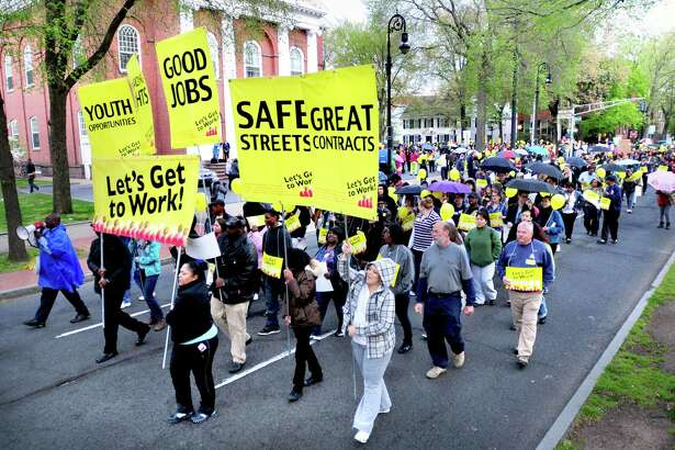 A jobs march heads down Temple St. in New Haven in 2012.