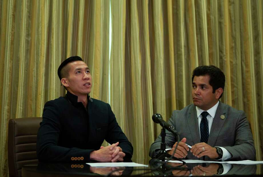 William Nguyen, who was recently released after being detained for taking part in a peaceful demonstration in Ho Chi Minh City in June, speaks with U.S. Congressman Jimmy Gomez (D-Los Angeles) during a press conference at the Houstonian on Thursday. Nguyen was born and raised in Houston, but he had been studying in Singapore before going to Vietnam this summer. Before leaving for Singapore, Nguyen was a constituent of Congressman Gomez while he lived in California. Photo: Mark Mulligan, Staff Photographer / © 2018 Mark Mulligan / Houston Chronicle