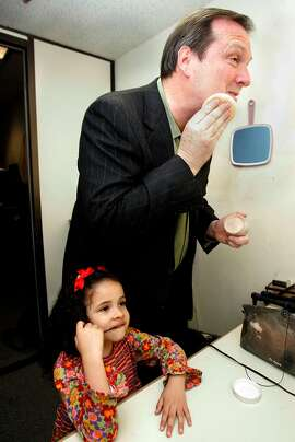 RADNICH17_026_LH.JPG   	Gary Radnich is celebrating his 20th anniversary as a sports anchor at KRON.  Jolie Radnich, 5 years old, watches as her dad puts on a little powder in the makeup room a few minutes before his broadcast.  Shot in San Francisco on 3/11/05.