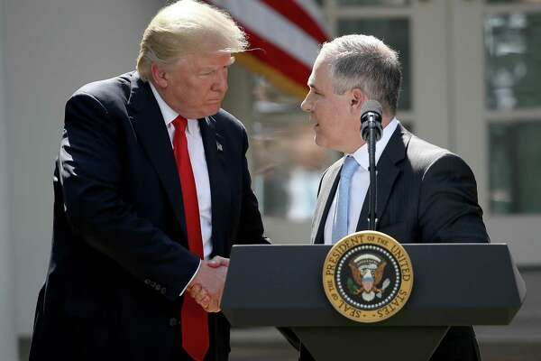 President Trump with former EPA Administrator Scott Pruitt. The Trump administration has stumbled in its efforts to roll back environmental regulations.