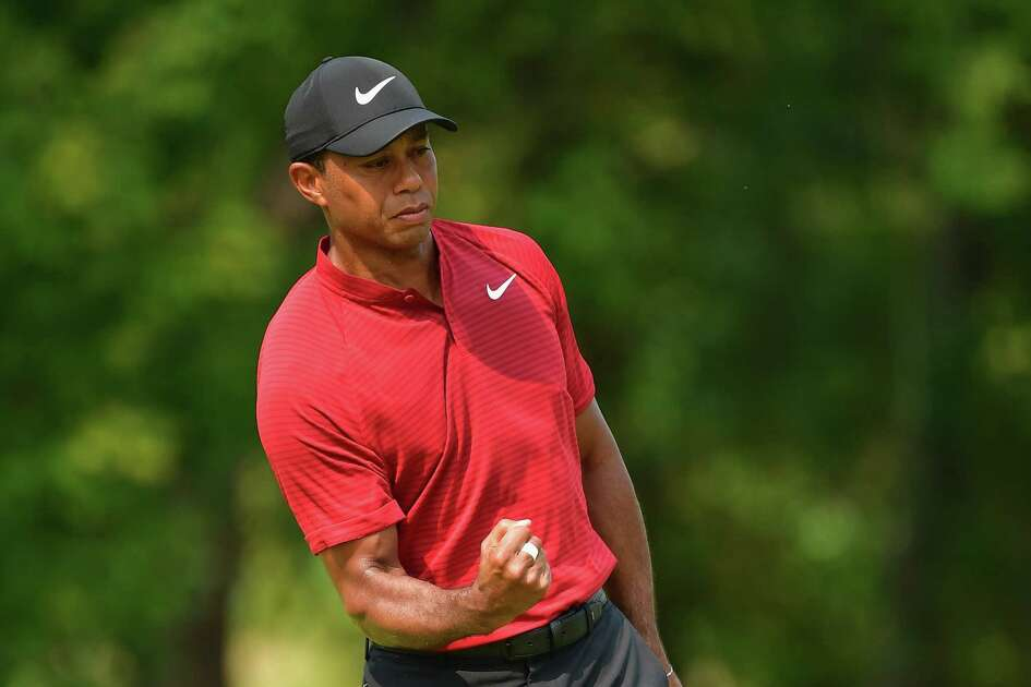 ST LOUIS, MO - AUGUST 12: Tiger Woods of the United States reacts after making a putt for birdie on the ninth green during the final round of the 2018 PGA Championship at Bellerive Country Club on August 12, 2018 in St Louis, Missouri.