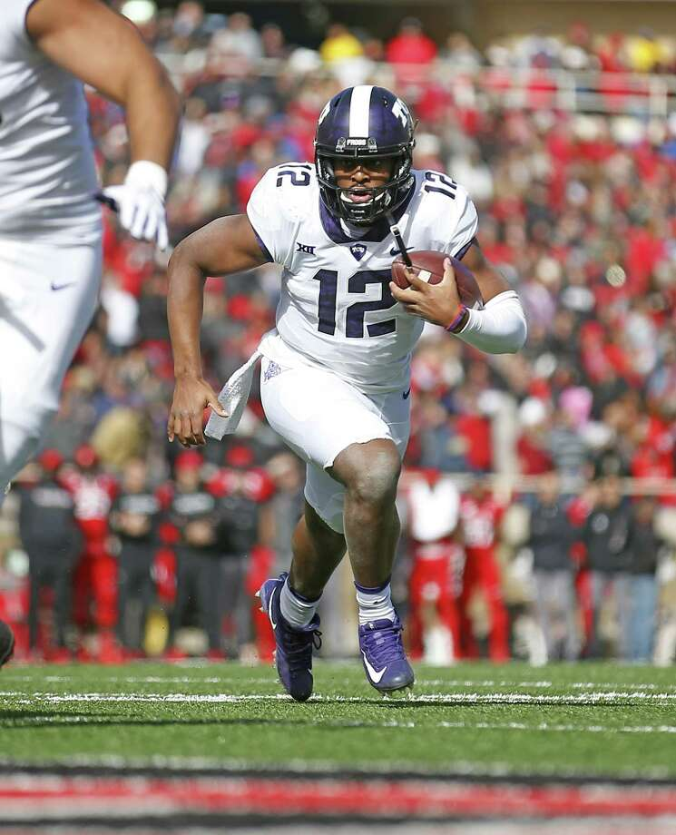 File- This Nov. 18, 2017, file photo shows TCU's Shawn Robinson (12) running down the field during the first half of an NCAA college football game against Texas Tech, Saturday in Lubbock, Texas.  Robinson won his only start last season, making the sophomore TCU's most experienced quarterback. Coach Gary Patterson has always said he judges quarterbacks by what they do on Saturdays. Robinson, filling in that mid-November day at Texas Tech for injured Kenny Hill, got a key victory that helped the Horned Frogs get into the Big 12 championship game on way to another 11-win season. (AP Photo/Brad Tollefson, File) Photo: Brad Tollefson, STR / Associated Press / Copyright 2017 The Associated Press. All rights reserved.