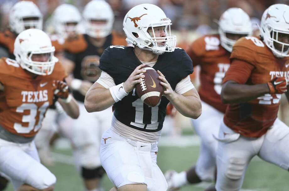 Sam Ehlinger sprints out looking for a receiver at the UT Orange-White Spring Game at DKR Stadium on April 21, 2018. Photo: Tom Reel, Staff / San Antonio Express-News / 2017 SAN ANTONIO EXPRESS-NEWS