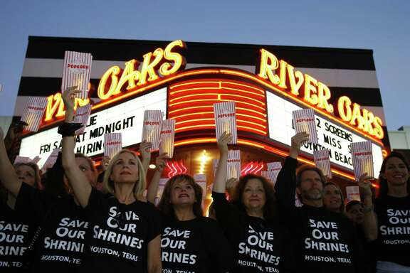 Members of the Save Our Shrine historical preservation organization gathered to take a promotional photo at the River Oaks Theatre Wednesday, August 30, 2006,  in Houston. Save Our Shrine organizer Carolyn Farb, says posing for the photo was also a peaceful protest to plans to tear down the theatre.