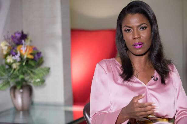 """Former White House staffer Omarosa Manigault Newman speaks during an interview with The Associated Press, Tuesday, Aug. 14, 2018, in New York. Manigault Newman declared she ?""""will not be silenced?"""" by President Donald Trump, remaining defiant as her public feud with her former boss shifted from a war of words to a possible legal battle. (AP Photo/Mary Altaffer)"""