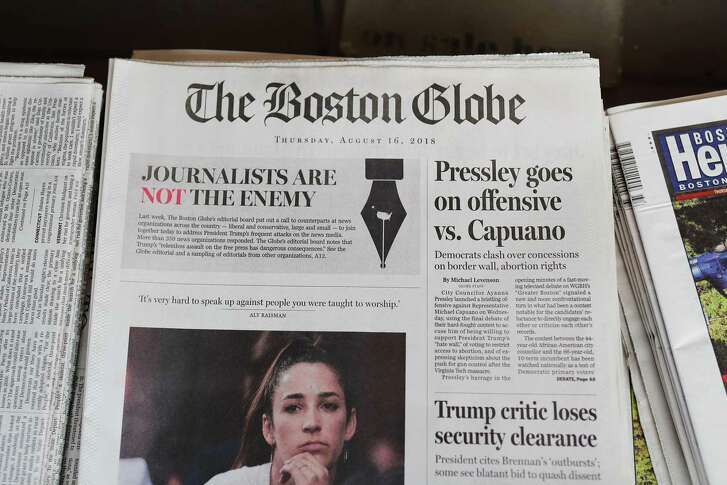 "The front page of the Thursday, Aug. 16, 2018 edition of the Boston Globe newspaper reads ""Journalists are Not the Enemy"" as it sits for sale at Out of Town News on August 16, 2018 in Cambridge, Massachusetts. Hundreds of U.S. newspapers joined together and published editorials decrying President Donald Trump's description of the media as the ""enemy of the people."""