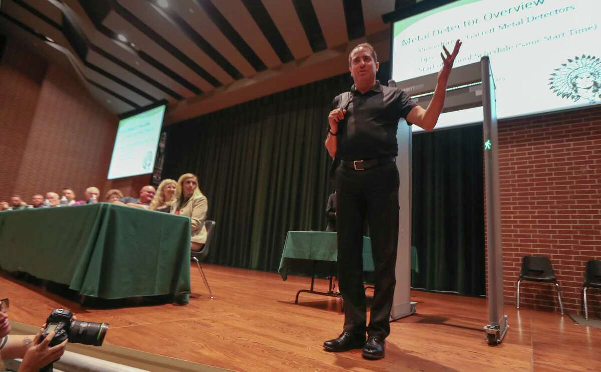 Garrett National Sales Security Sales Manger, Joe Vazquez demonstrates the new metal detectors to the Santa Fe ISD's board, administration, parents and concern citizens in the Santa Fe High School's auditorium Thursday, Aug. 16, 2018, in Santa Fe.