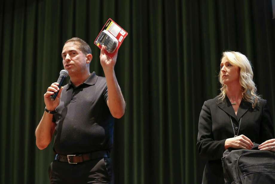 Garrett National Sales Security Sales Manger Joe Vazquez shows items for the ideal backpack with the help of Principal Racheal Blundell  in the Santa Fe High School's auditorium Thursday, Aug. 16, 2018. Photo: Steve Gonzales, Staff Photographer / © 2018 Houston Chronicle