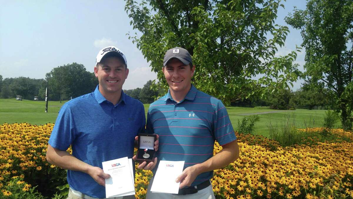 Jim Gifford of Clifton Park, left, and former Siena basketball player Kyle Downey of Rochester hold their invitations to the U.S. Mid-Amateur Championship. The two were co-medalists Thursday, Aug. 16, 2018, in the qualifier at the Edison Club in Rexford. (Pete Dougherty / Times Union)