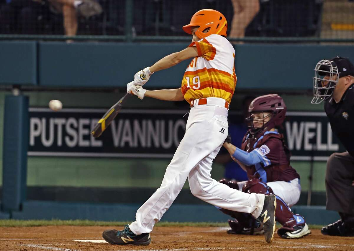 Houston, Texas' Ryan Selvaggi (19) drives in a run with a triple off Coventry, Rhode Island pitcher Tommy Turner (9) during the third inning of a baseball game in United States pool play at the Little League World Series tournament in South Williamsport, Pa., Thursday, Aug. 16, 2018. Texas won 3-1. (AP Photo/Gene J. Puskar)