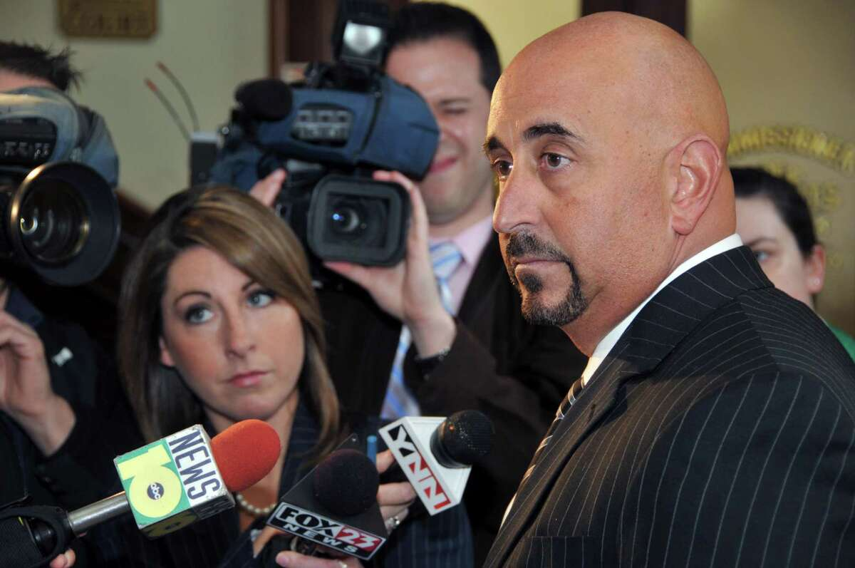 Attorney for Travis M. Carroll, Gerard Amedio (at right) speaks to the media at Saratoga City Hall Thursday morning March 25, 2010. Carroll is charged in connection with the death on March 18 of Ryan Rossley. (John Carl D'Annibale / Times Union)